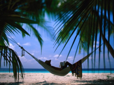 stuart-westmorland-woman-in-hammock-on-beach-ari-atoll-maldives